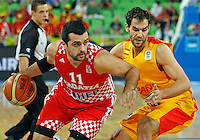 "Croatia`s Krunoslav Simon (L) and Jose Calderon of Spain (R) in action during European basketball championship ""Eurobasket 2013""  basketball game for 3rd place between Spain and Croatia in Stozice Arena in Ljubljana, Slovenia, on September 22. 2013. (credit: Pedja Milosavljevic  / thepedja@gmail.com / +381641260959)"