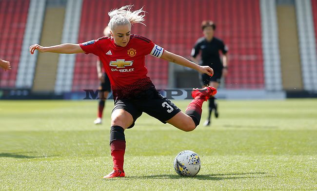 Alex Greenwood of Manchester United Women tries a shot on goal