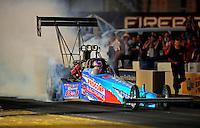 Oct. 14, 2011; Chandler, AZ, USA; NHRA top fuel dragster driver Mike Strasburg during qualifying at the Arizona Nationals at Firebird International Raceway. Mandatory Credit: Mark J. Rebilas-
