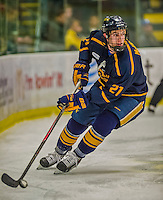 29 December 2013:  Canisius College Golden Griffins defenseman Duncan McKellar, a Senior from Phoenix, AZ, in second period action against the University of Vermont Catamounts at Gutterson Fieldhouse in Burlington, Vermont. The Catamounts defeated the Golden Griffins 6-2 in the 2013 Sheraton/TD Bank Catamount Cup NCAA Hockey Tournament. Mandatory Credit: Ed Wolfstein Photo *** RAW (NEF) Image File Available ***