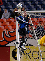 Colorado forward Jean Phillippe Peguero challenges FC Dallas goalkeeper Scott Garlick for a crossed ball. The Colorado Rapids drew 0-0 with FC Dallas in the first game of the Western Conference Semi-finals Invesco Field at Mile High, Denver, Colorado, September 22, 2005.