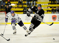 30 December 2007: Western Michigan University Broncos' left wing forward Cam Watson, a Sophomore from Cambridge, Ontario, in action against the Holy Cross Crusaders at Gutterson Fieldhouse in Burlington, Vermont. The teams skated to a 1-1 tie, however the Broncos took the consolation game in a 2-0 shootout to win the third game of the Sheraton/TD Banknorth Catamount Cup Tournament...Mandatory Photo Credit: Ed Wolfstein Photo