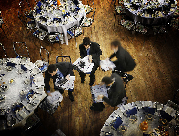 KPMG Graduates, pictured here preparing information packs for guests attending the KPMG Budget Breakfast Briefing 2010 held in the Mansion House, Dublin. Over 700 of Ireland's top business leaders gathered to be briefed on the tax implications from yesterday's Budget by KPMG tax Partners. Pic. Robbie Reynolds/CPR..