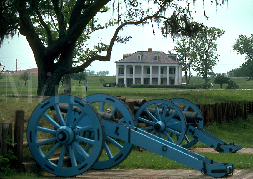 The Chalmette Battlefield with cannons in the foreground and a plantation house in the background. Vacherie, Louisiana.
