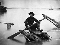 Expedients for Crossing Streams.  A pair of small pontoons, designed to facilitate scouting operations.  A boat can be made of these by running a pole through the loops, and then placing sticks across.  Ca.  1863.  Capt. Andrew J. Russell.  (Corps of Engineers)<br /> Exact Date Shot Unknown<br /> NARA FILE #:  077-F-194-6-21<br /> WAR & CONFLICT BOOK #:  206