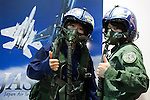 """Visitors wearing militar pilots' helmet pose for the cameras at the Niconico Douga fan event at Makuhari Messe International Exhibition Hall on April 25, 2015, Chiba, Japan. The event includes special attractions such as J-pop concerts, Sumo and Pro Wrestling matches, cosplay and manga and various robot performances and is broadcast live on via the video-sharing site. Niconico Douga (in English """"Smiley, Smiley Video"""") is one of Japan's biggest video community sites where users can upload, view, share videos and write comments directly in real time, creating a sense of a shared watching. According to the organizers more than 200,000 viewers for two days will see the event by internet. The popular event is held in all 11 halls of the huge Makuhari Messe exhibition center from April 25 to 26. (Photo by Rodrigo Reyes Marin/AFLO)"""