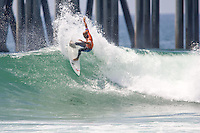 American Kelly Slater with a tail slide during round of 96 at the 2010 US Open of Surfing in Huntington Beach, California on August 4, 2010.