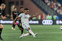 FOXBOROUGH, MA - AUGUST 4: Teal Bunbury #10 of New England Revolution passes the ball during a game between Los Angeles FC and New England Revolution at Gillette Stadium on August 3, 2019 in Foxborough, Massachusetts.