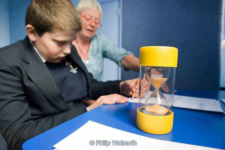 A pupil does a timed maths exercise in the blue-painted 'calm' room at Hendon Autism Resource Provision (HARP) at Hendon School, Barnet, London.