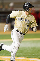 Mark Rhine (2) of the Wake Forest Demon Deacons hustles down the first base line against the North Carolina State Wolfpack at Wake Forest Baseball Park on March 15, 2013 in Winston-Salem, North Carolina.  The Wolfpack defeated the Demon Deacons 12-6.  (Brian Westerholt/Four Seam Images)