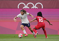 KASHIMA, JAPAN - AUGUST 2: Tobin Heath #7 of the United States dribbles the ball past Ashley Lawrence #10 of Canada during a game between Canada and USWNT at Kashima Soccer Stadium on August 2, 2021 in Kashima, Japan.