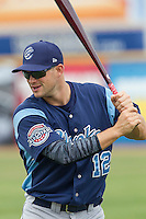 Corpus Christi Hooks first baseman Conrad Gregor (12) warms up before the Texas League baseball game against the San Antonio Missions on May 10, 2015 at Nelson Wolff Stadium in San Antonio, Texas. The Missions defeated the Hooks 6-5. (Andrew Woolley/Four Seam Images)
