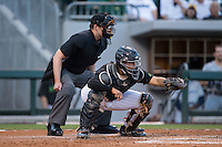 Charlotte Knights catcher Omar Narvaez (14) frames a pitch as home plate umpire John Bacon looks on during the game against the Columbus Clippers at BB&T BallPark on May 3, 2016 in Charlotte, North Carolina.  The Clippers defeated the Knights 8-3.  (Brian Westerholt/Four Seam Images)