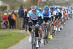 The peloton led by Omega Pharma-Quickstep on the 2nd cobbled section at Doorn during the 96th edition of The Tour of Flanders 2012, running 256.9km from Bruges to Oudenaarde, Belgium. 1st April 2012. <br /> (Photo by Eoin Clarke/NEWSFILE).