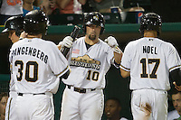 San Antonio Missions third baseman Jake Blackwood (10) greets teammates Cory Spagenberg (30) and Rico Noel (17) after they scored during the Texas League baseball game against the Midland RockHounds on July 13, 2013 at Nelson Wolff Municipal Stadium in San Antonio, Texas. The Missions defeated the Rock Hounds 5-4. (Andrew Woolley/Four Seam Images)