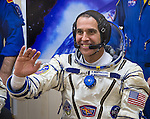 Expedition 38 Flight Engineer Rick Mastracchio of NASA is seen through glass as he and fellow crew mates, Soyuz Commander Mikhail Tyurin of Roscosmos, and, Flight Engineer Koichi Wakata of the Japan Aerospace Exploration Agency, have their Russian Sokol suits pressure checked a few hours ahead of their launch, Thursday, Nov. 7, 2013, in Baikonur, Kazakhstan. Tyurin, Wakata, and, Mastracchio will launch in their Soyuz TMA-11M spacecraft to the International Space Station to begin a six-month mission. Photo Credit (NASA/Bill Ingalls)