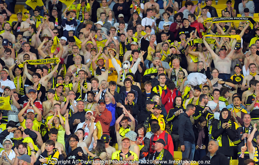 Phoenix fans celebrate during the A-League football match between Wellington Phoenix and Melbourne Victory FC at Sky Stadium in Wellington, New Zealand on Sunday, 15 March 2020. Photo: Dave Lintott / lintottphoto.co.nz