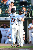 Rochester Red Wings designated hitter Nate Hanson (19) hugs second baseman Eric Farris (5) after hitting a home run during the second game of a doubleheader against the Buffalo Bisons on July 6, 2014 at Frontier Field in Rochester, New  York.  Rochester defeated Buffalo 6-1.  (Mike Janes/Four Seam Images)