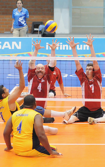 Larry Matthews and Douglas Learoyd, Guadalajara 2011 - Sitting Volleyball // Volleyball Assis.<br /> Team Canada takes on Columbia in the Bronze Medal Game // Équipe Canada affronte Columbia dans le match pour la médaille de bronze. 11/18/2011.