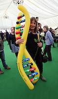 Wednesday 28 May 2014, Hay on Wye, UK<br /> Pictured: A woman carrying an inflatable DNA Deoxyribonucleic Acid.<br /> Re: The Hay Festival, Hay on Wye, Powys, Wales UK.