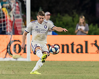 FOXBOROUGH, MA - JULY 28: Dillon Powers #5 passes the ball during a game between Orlando City SC and New England Revolution at Gillette Stadium on July 27, 2019 in Foxborough, Massachusetts.