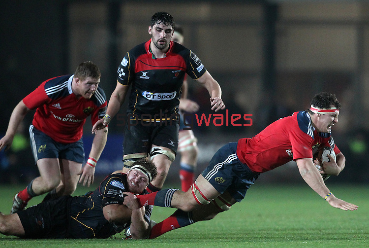 Robin Copeland of Munster Rugby is brought to the ground by Loose-head prop Brok Harris of Newport Gwent Dragons.<br /> <br /> Guiness Pro 12<br /> Newport Gwent Dragons v Munster Rugby<br /> Rodney Parade<br /> 21.11.14<br /> ©Steve Pope-SPORTINGWALES