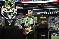 SEATTLE, WA - NOVEMBER 10: Pearl Jam guitarist Mike McCready performs the Star Spangled Banner on his guitar during a game between Toronto FC and Seattle Sounders FC at CenturyLink Field on November 10, 2019 in Seattle, Washington.