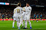 Luka Modric (L) and Sergio Ramos (R) of Real Madrid celebrate goal during La Liga match between Real Madrid and Real Sociedad at Santiago Bernabeu Stadium in Madrid, Spain. November 23, 2019. (ALTERPHOTOS/A. Perez Meca)