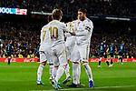 Luka Modric (L) and Sergio Ramos (R) of Real Madrid celebrate goal during La Liga match between Real Madrid and Real Sociedad at Santiago Bernabeu Stadium in Madrid, Spain. November 23, 2019. (ALTERPHOTOS/A. Perez Meca)