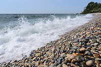 A Lake Michigan wave crashing ashore at historic Slag Beach, Fayette Historic State Park.