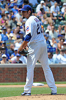 Chicago Cubs starting pitcher Matt Garza #22 looks in for signals during a game against the Arizona Diamondbacks at Wrigley Field on July 15, 2012 in Chicago, Illinois. The Cubs defeated the Diamondbacks 3-1. (Tony Farlow/Four Seam Images).