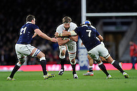 Geoff Parling of England is tackled by Adam Ashe (left) and Blair Cowan of Scotland