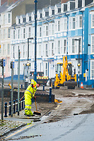 "Pictured: Council workers clear debris off the promenade of the seaside town of Aberystwyth, Wales, UK. Monday 23 October 2017<br /> Re: A clean operation is under way at coastal parts of the UK were affected by Storm Brian.<br /> Roads in Aberystwyth's seafront and at nearby Aberaeron, Wales were shut on Saturday morning as a yellow ""be aware"" Met Office warning is in place."