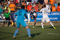 Zack Schilawski (22) of the Carolina Railhawks crosses the ball past Tommy Meyer (21) of the LA Galaxy during a third round match in the US Open Cup at WakeMed Soccer Park in Cary, NC.  The Carolina Railhawks defeated the LA Galaxy, 2-0.