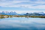 Austria, Tyrol, above Kirchberg in Tyrol, near Kitzbuhel: reservoir 'Ehrenbachhoehe', at background Loferer Steinberge mountains (left) and Leoganger Steinberge mountains (right) | Oesterreich, Tirol, oberhalb Kirchberg in Tirol: Speichersee Ehrenbachhoehe, im Hintergrund die Loferer Steinberge (links) und die Leoganger Steinberge (rechts)