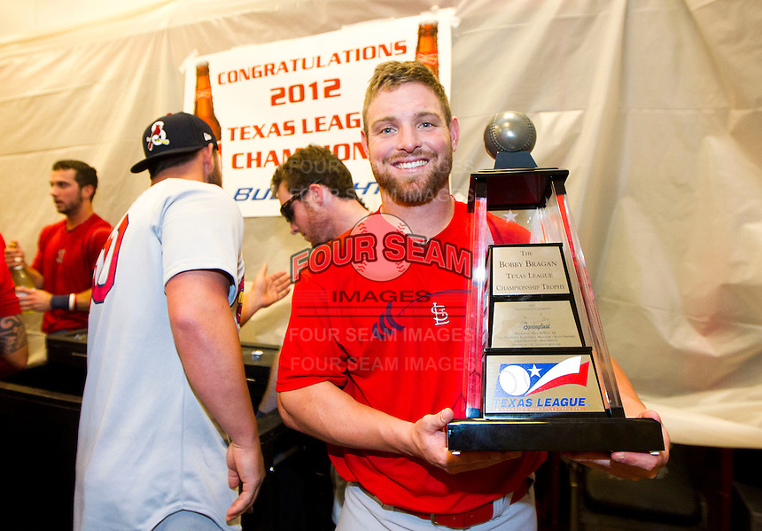 Scott Gorgen (32) of the Springfield Cardinals stands with the Texas League Championship trophy after game 4 of the Texas League Championship Series against the Frisco RoughRiders at Dr. Pepper BallPark on September 15, 2012 in Frisco, TX.  The Cardinals became the 2012 Texas League Champions after defeating the RoughRiders 2-1. (David Welker/Four Seam Images)