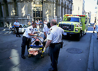 File Photo<br /> <br /> Urgences Sante Paramedics administer first aid to a wounded man on a stretcher in the street of Montreal<br /> <br /> <br /> Mandatory Credit: Photo by Pierre Roussel- Images Distribution. (©) Copyright 2004 by Pierre Roussel <br /> <br /> NOTE : scan from 2 1/4 slide