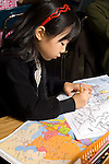 Education elementary school grade 3 girl working on map