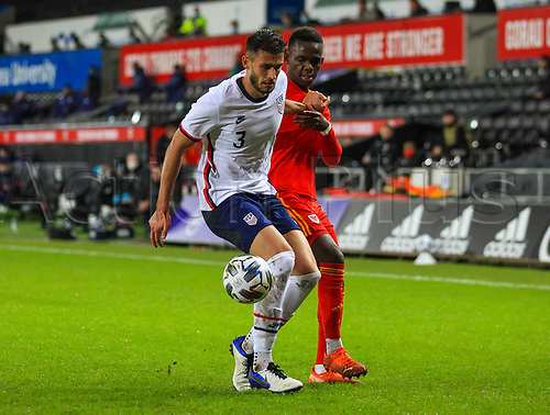 12th November 2020; Liberty Stadium, Swansea, Glamorgan, Wales; International Football Friendly; Wales versus United States of America; Matt Miazga of USA holds off the challenge from Rabbi Matondo of Wales
