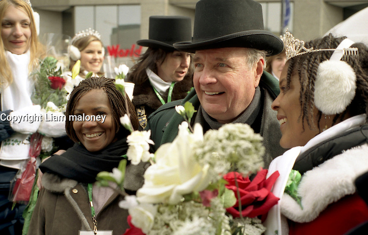 March 14 2004  Montreal, Quebec, Canada.<br /> <br /> Paul martin, Prime Minister, CANADA (L) and Tara Hecksher (R) , Half-irish and Half Nigerian Queen of the<br /> Saint-Patrick Day Parade in Montreal, March 14 2004<br /> <br /> <br /> Mandatory Credit: Photo by  Liam Maloney - Images Distribution. (©) Copyright 2004 by Liam Maloney
