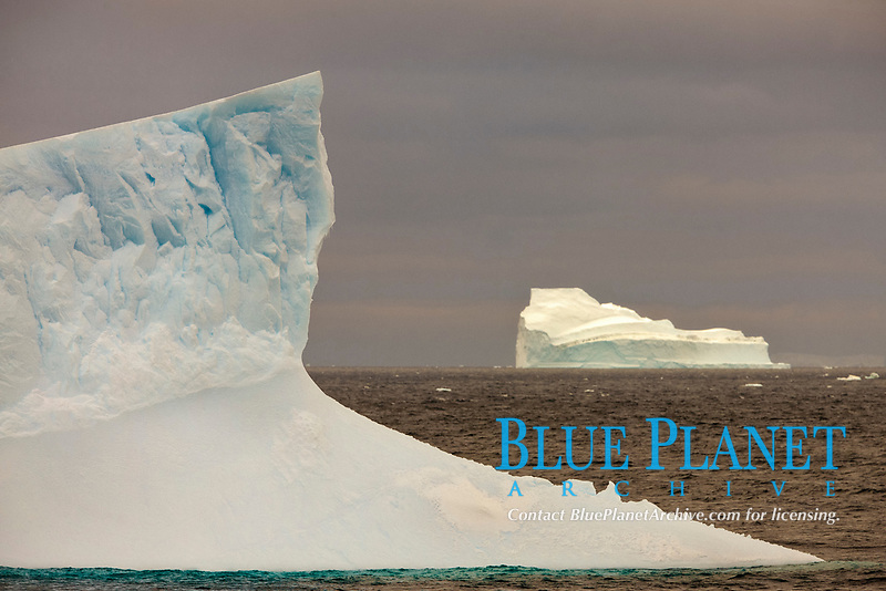 Iceberg, ocean, light and clouds.  Light plays over icebergs and the ocean near Coronation Island.