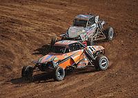 Mar. 19, 2011; Chandler, AZ, USA;  LOORRS pro buggy unlimited driver Bobby Pecoy leads Jerry Whelchel during round one at Firebird International Raceway. Mandatory Credit: Mark J. Rebilas-