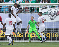 CHARLOTTE, NC - JUNE 23: Derek Cornelius #4 and Doneil Henry #15 attempt to head the ball away from the goal as Milan Borjan #18 and Lucas Cavallini #19 look on during a game between Cuba and Canada at Bank of America Stadium on June 23, 2019 in Charlotte, North Carolina.