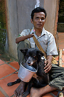 Mans best friend the dog collecting some donation for a mine victim from the Siam reap Area, he lost his hand and eyesight due to an exploding land mine, the left overs from the war