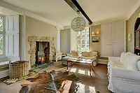 BNPS.co.uk (01202) 558833<br /> Pic: KnightFrank/BNPS<br /> <br /> A roomy living space<br /> <br /> A historic English country estate with a French chateau feel and royal connections is on the market for £5.5m.<br /> <br /> The site of Grade II listed Yarner House was once governed by William the Conqueror, mentioned in the Domesday Book and a popular hunting site in Tudor times.<br /> <br /> The seven-bedroom house sits in a 247-acre estate on the edge of Dartmoor National Park and has stunning views over the surrounding landscape, including Yarner Wood.<br /> <br /> The ancient woodland was once part of the property until 1952 when it was sold to the Nature Conservancy to become one of the first national nature reserves.<br /> <br /> Where the current Yarner House is built, it is thought to have had a hunting lodge in Tudor times, with connections to Henry VII, Henry VIII, Edward VI and Queen Mary.