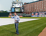 2011 Kentucky Derby winning trainer H. Graham Motion prepares to throw out the first pitch at Camden Yards in Baltimore