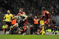 Seb Stegman of Harlequins is tackled by David Strettle of Saracens during the Aviva Premiership match between Harlequins and Saracens at Twickenham on Tuesday 27 December 2011 (Photo by Rob Munro)