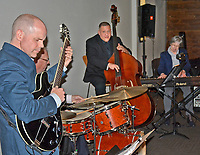 Janelle Jessen/Herald-Leader<br /> Guitarist Ben Harris (left), drummer Steve Wilkes, bassist Kyth Trantham and pianist Claudia Burson perform during Siloam Springs Center for the Arts' Jazz at the Springs on Saturday evening.