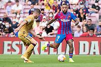 26th September 2021;   Nou Camp, Barcelona, Spain: La Liga football, FC Barcelona versus Levante: Memphis Depay of Barcelona plays the ball inside Postigo