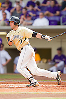 Carlos Lopez #3 of the Wake Forest Demon Deacons follows through on his swing against the LSU Tigers at Alex Box Stadium on February 20, 2011 in Baton Rouge, Louisiana.  The Tigers defeated the Demon Deacons 9-1.  Photo by Brian Westerholt / Four Seam Images